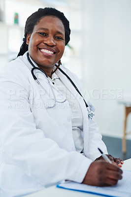 Buy stock photo Cropped shot of a female doctor doing paperwork in her office