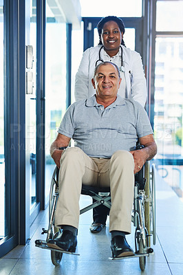 Buy stock photo Shot of a female doctor seeing a patient in a wheelchair