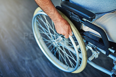 Buy stock photo Closeup shot of an unrecognizable man sitting in a wheelchair