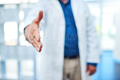 Buy stock photo Cropped shot of a doctor extending his arm for a handshake