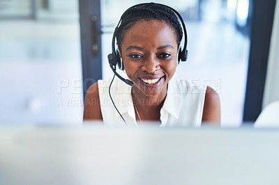 Buy stock photo Shot of a young woman working in a call centre