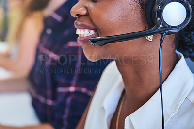 Buy stock photo Cropped shot of young woman working in a call center