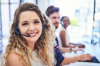 Buy stock photo Portrait of a team of young people working in a call centre