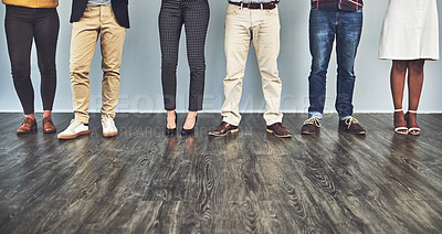 Buy stock photo Cropped shot of a group of businesspeople standing against a wall
