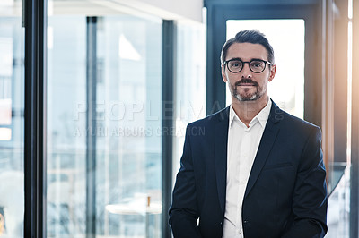 Buy stock photo Portrait of a confident mature businessman working in a modern office