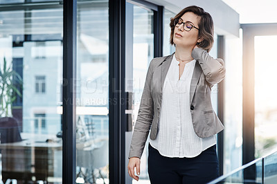 Buy stock photo Shot of a young businesswoman expressing tension in a modern office