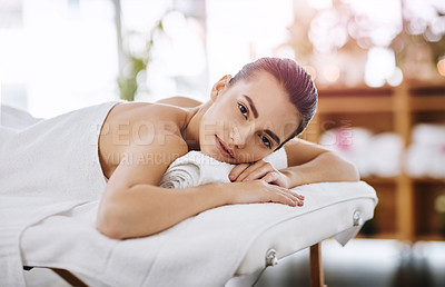 Buy stock photo Portrait of an attractive young woman getting pampered at a beauty spa