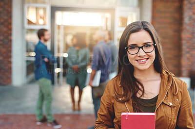 Buy stock photo Portrait of a happy young woman standing outdoors on campus
