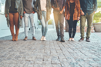 Buy stock photo Cropped shot of a group of young students standing together outdoors on campus