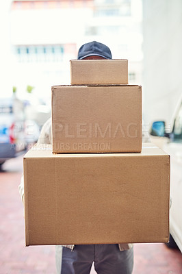 Buy stock photo Shot of a courier holding a pile of boxes for delivery