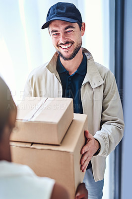 Buy stock photo Shot of a courier making a delivery to a businesswoman at her office