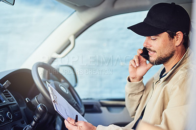 Buy stock photo Shot of a courier talking on a cellphone while sitting in a delivery van