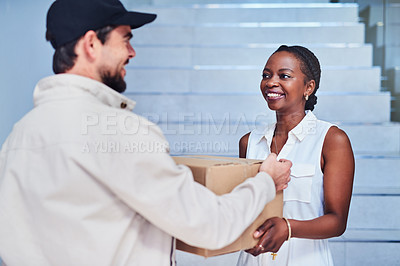 Buy stock photo Shot of a businesswoman receiving a delivery from the courier