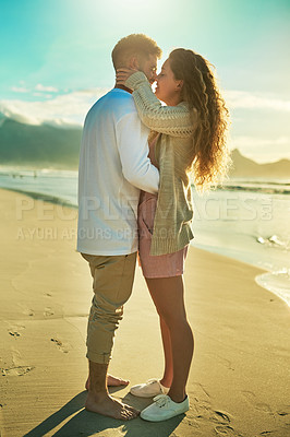 Buy stock photo Full length shot of an affectionate young couple sharing an intimate moment on the beach