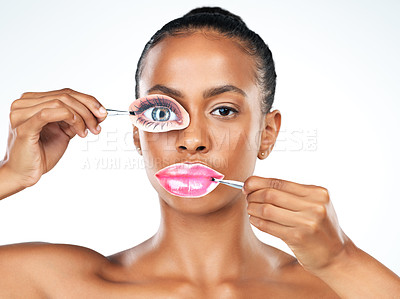 Buy stock photo Studio shot of a attractive young woman holding disguises   over her eye and mouth while standing against a white background