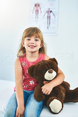 Buy stock photo Cropped portrait of an adorable little girl sitting in a paediatrician's office with her teddy
