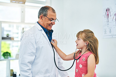 Buy stock photo Cropped shot of a little girl in her paediatrician's office