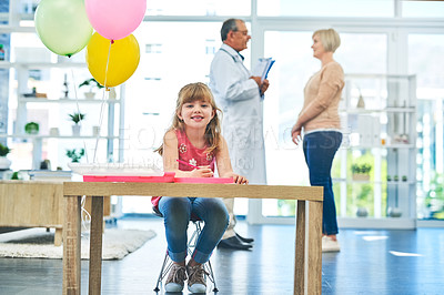 Buy stock photo Shot of an adorable little girl playing in a paediatrician's office