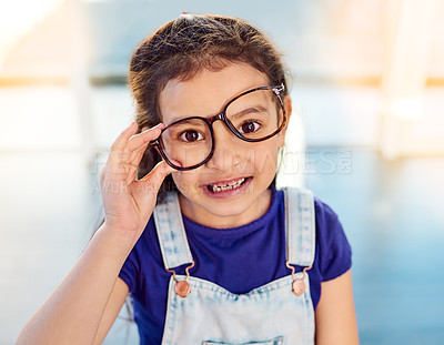 Buy stock photo Portrait of an adorable little girl posing with glasses on at home