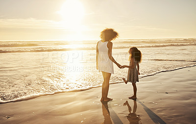 Buy stock photo Shot of a young family enjoying some time on the beach