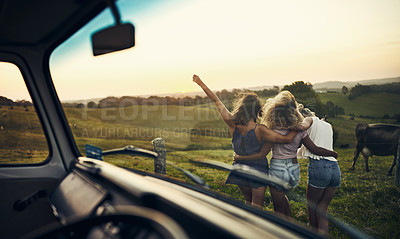Buy stock photo Cropped shot of three girlfriends out on a road trip