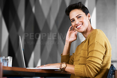 Buy stock photo Cropped portrait of a confident and attractive young businesswoman working in her office