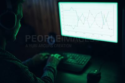 Buy stock photo Cropped shot of a young man hacking in a dark room