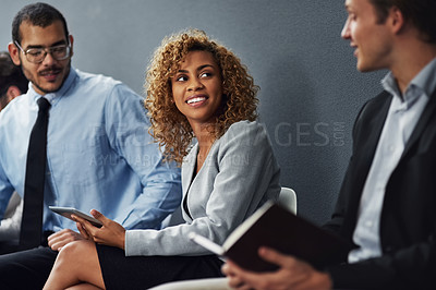 Buy stock photo Cropped shot of a group of businesspeople waiting in line for a job interview