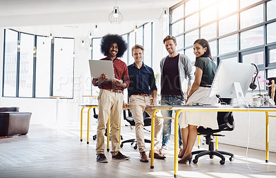 Buy stock photo Portrait of a team of happy designers working at a desk in their modern office