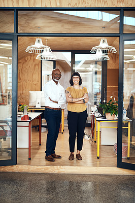 Buy stock photo Portrait of two confident designers standing together in an office