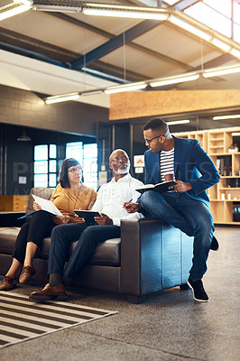 Buy stock photo Full length shot of a group of designers having a discussion in an office
