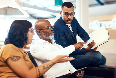 Buy stock photo Shot of a group of designers having a discussion in an office