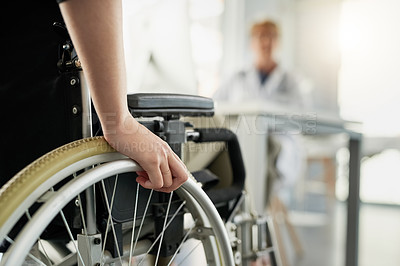 Buy stock photo Cropped shot of an unrecognizable woman in a wheelchair visiting the doctor's rooms for a consultation