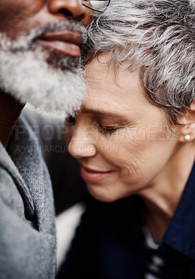 Buy stock photo Closeup up shot of an affectionate senior couple relaxing on the sofa at home