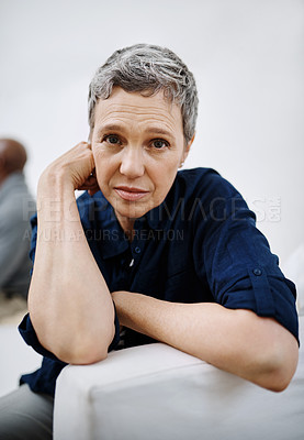 Buy stock photo Closeup shot of an unhappy senior women posing with her husband in the background at home