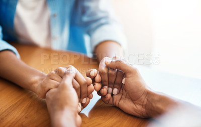 Buy stock photo Closeup shot of two unrecognizable people holding hands in comfort at home
