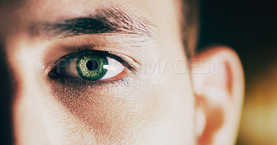 Buy stock photo Studio shot of a man opening his eyes against a dark background