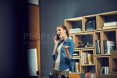 Buy stock photo Shot of a young businesswoman using a mobile phone and looking surprised in a modern office