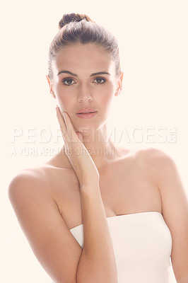 Buy stock photo Cropped shot of a beautiful young woman posing against a light background