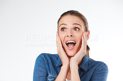 Buy stock photo Studio shot of an attractive young woman looking amazed against a grey background