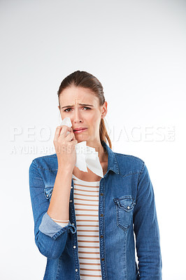 Buy stock photo Studio shot of a young woman expressing negative emotions against a grey background