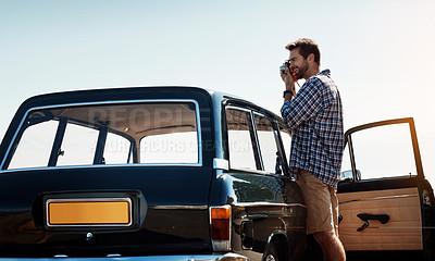 Buy stock photo Cropped shot of a handsome man taking photos while enjoying a road trip