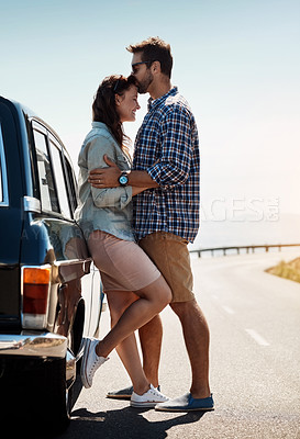 Buy stock photo Shot of an affectionate couple out on a road trip