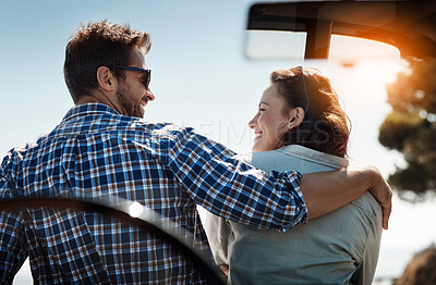 Buy stock photo Rearview shot of an affectionate couple taking in the sights while enjoying a road trip