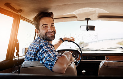 Buy stock photo Rearview portrait of a handsome man enjoying a summer road trip