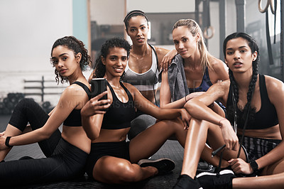 Buy stock photo Shot of a group of fit young women taking a selfie together at the gym