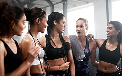 Buy stock photo Shot of a group of fit young women chatting together at the gym