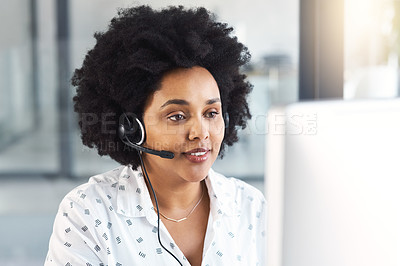 Buy stock photo Shot of a call centre agent working on a computer in an office
