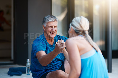 Buy stock photo Shot of a mature and motivated couple congratulating each other at the end of an intense workout session