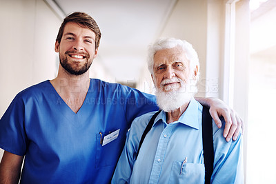 Buy stock photo Portrait of a young doctor and his senior patient posing together in the hospital